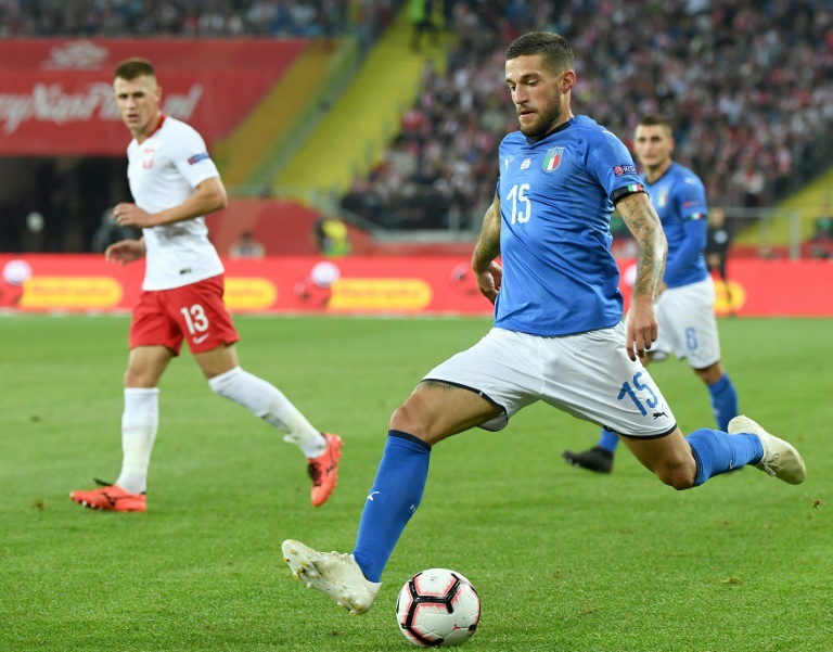 Last-gasp Biraghi saves Italy, gives Mancini first competitive win